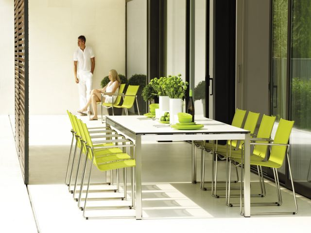 Gloster Azore table with Lime Asta Chairs. Marine Grade stainless steel.