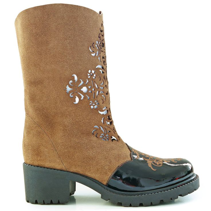 Boots inspired by Islamic art. Made from natural leather and embellished with…
