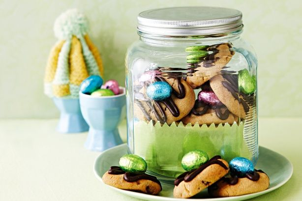 Choc-topped and choc-filled, these Easter bikkies have a little bit of spice and everything nice.