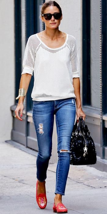 The style icon paired her mesh sweater and distressed AG Jeans with a statement cuff, Westward Leaning shades, a handbag with scaly detailing and embroidered coral loafer slippers.