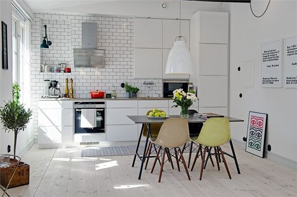 I'm becoming a sucker for bright, white kitchens and dining spaces with different coloured chairs