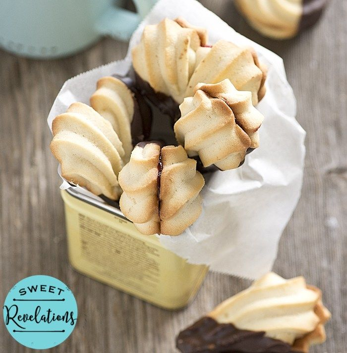 A classic recipe for easy Piped Spritz Cookies with just a hint of lemon flavor. These are perfect with a steaming cup of tea!