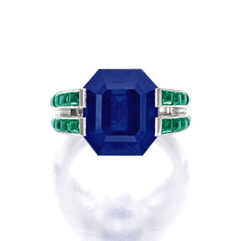 Cartier - Fine Sapphire, Emerald and Diamond Ring - Centring on a step-cut sapphire weighing approximately 12.00 carats, flanked by calibré-cut emeralds together weighing approximately 1.60 carats; sold2,321,078 USD; 07/10/14.