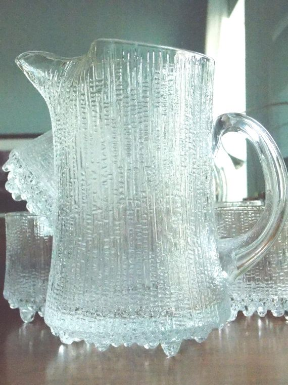 perfect for lemonade: Iittala Ultima Thule ice glass pitcher designed by Tapio Wirkkala in 1968 from MidCenturyFLA on etsy $85.00