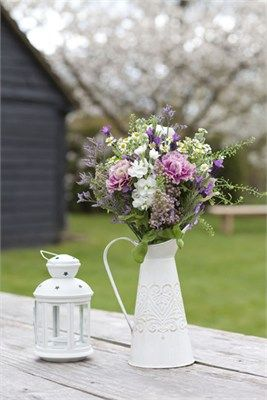 mix of spring country garden flowers in jugs,photo courtesy of www.twsp.co.uk