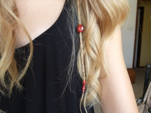braid hair, put on beads, tie small see-through elastic on end to keep beads in place.