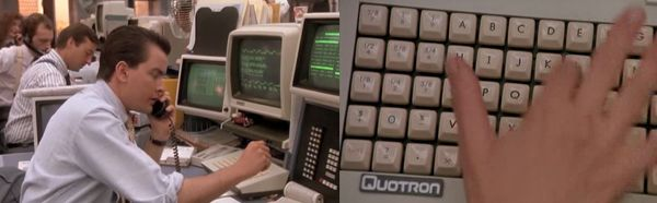 Charlie Sheen as Bud Fox in the 1988 Movie 'Wall Street' at his green 'Quotron' screens and chiclet keyboard.