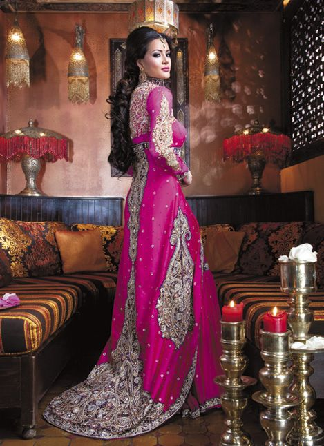 Stunning! This Indian bride is vibrant in magenta and gold. We love the colour and the detailed embroidery - we often get brides who want to match the cake to their dresses, and the corresponding cake to this dress would be magnificent.