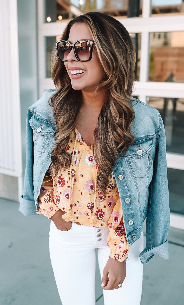 orange floral V-neck long-sleeved shirt, white fitted pants, and blue denim button-up jacket #spring #outfits
