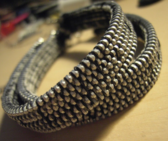 Cuffs made of zippers.