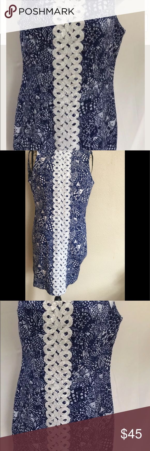 Lilly Pulitzer Blue and white shift dress Lilly Pulitzer shift dress size 6 Upstream Blue and White Fish Print Shell 98% cotton 2 % Spandex Solid white lining 100% cotton Vertical white spiral accent Gold pineapple metal zipper Measurements: Chest : 34 inch circumference Shoulder to hem length: 34 inches Lilly Pulitzer Dresses Midi