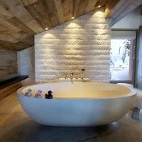 Bathroom. rustic bathroom interior with handmade oval concrete stand alone tub under natural varnished wood ceiling. Elegant Stand Alone Bathtubs For Bathroom Interior