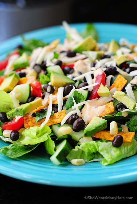 This Black Bean Mexican Salad just hits the spot! It's a fabulous salad to serve as a main dish for a group. | shewearsmanyhats.com