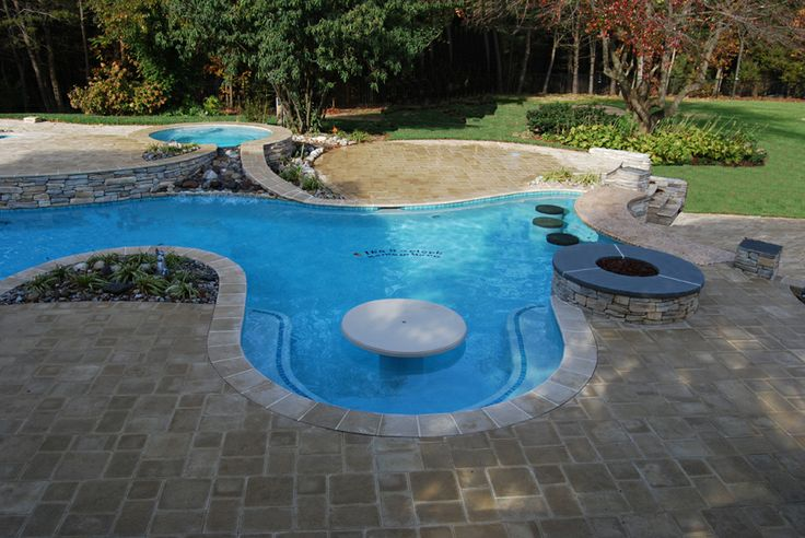 Swim up pool table in the backyard swimming pool for Swimming pool accessories