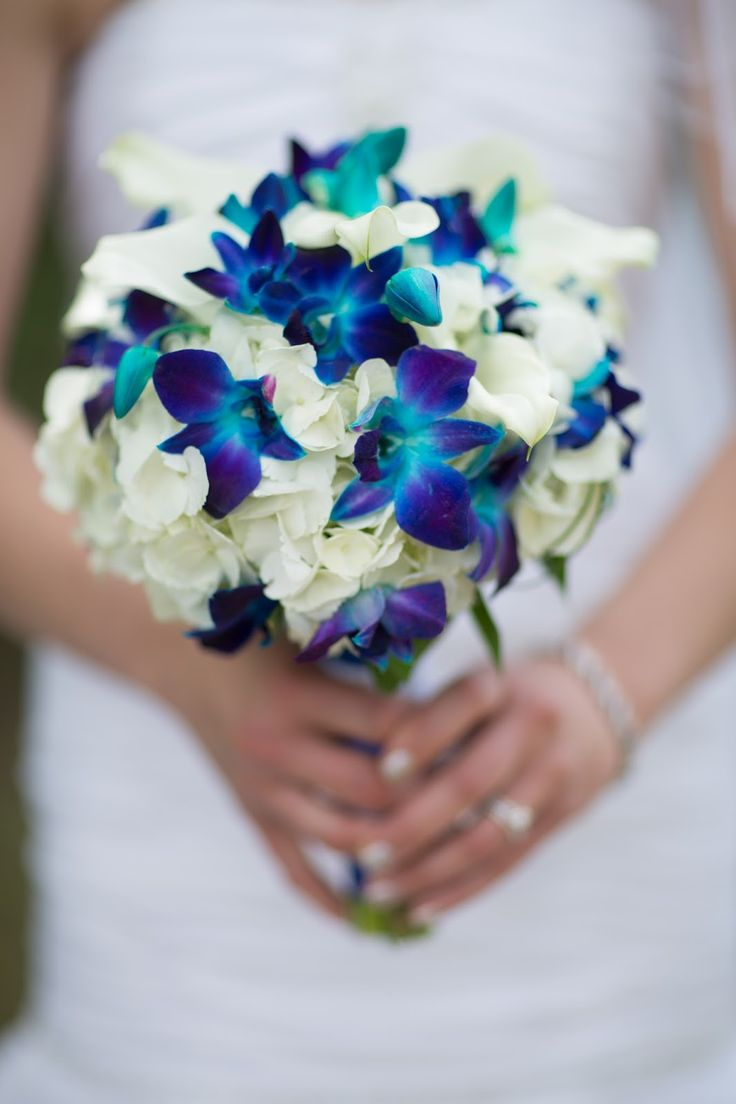 Blue orchids, mini white callas and white hydrangeas for bridesmaids. And maybe something a little larger or possibly a cascading bouquet for the bride