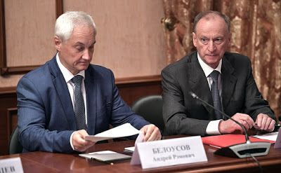 Presidential Aide Andrei Belousov (left) and Secretary of the Security Council Nikolai Patrushev before the meeting of Military-Industrial Commission.