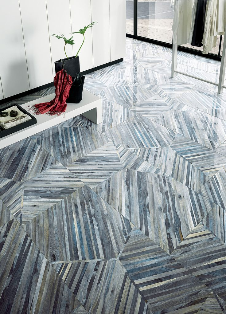 PIN NINE: Piece of slate have been used in this interior for flooring. The placement of the small piece of slate create an overall larger shape and show pattern and texture.
