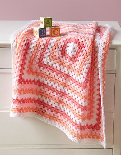 Pretty but simple granny square blanket. I had one just like this but in shades of pink. It was lost when my house got hit by hurricane Ivan.