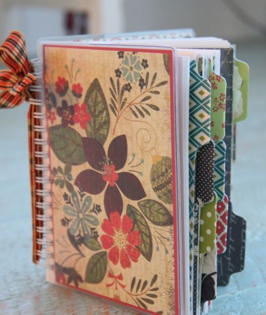 Planner/Scrapbook. Stacy Julian. Add scrapbooking papers and punched tabs to a yearly purse calendar, which can then take photos and memorabilia for the year and become a mini scrapbook!