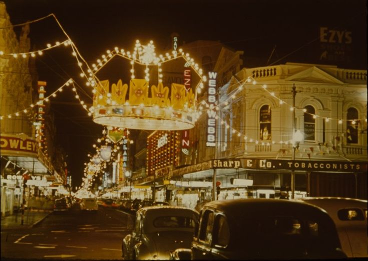 144183PD: Decorative street lighting for royal visit, Hay Street Barrack Street intersection, Perth, 1954. http://encore.slwa.wa.gov.au/iii/encore/record/C__Rb3880507