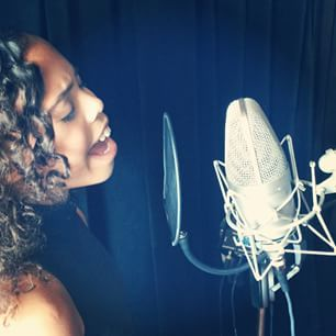 Asia Monet Ray in the studio