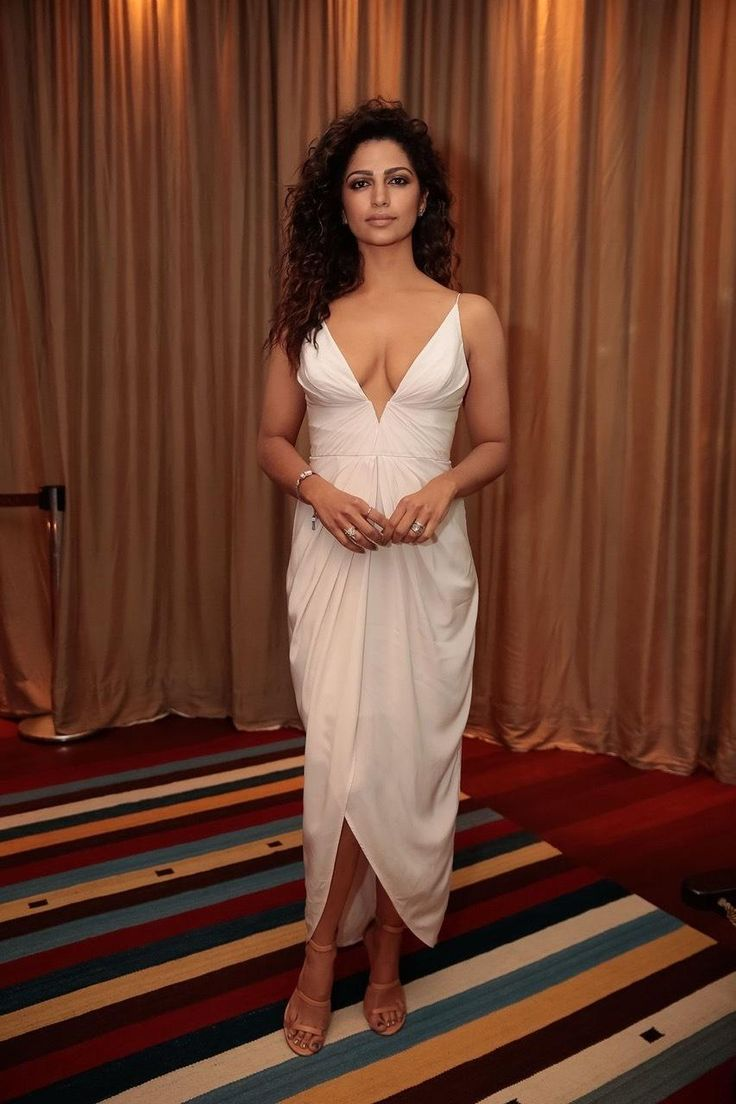 Camila Alves wearing Tamara Mellon Frontline Sandals and Zimmermann Silk V Tuck Long Dress in White