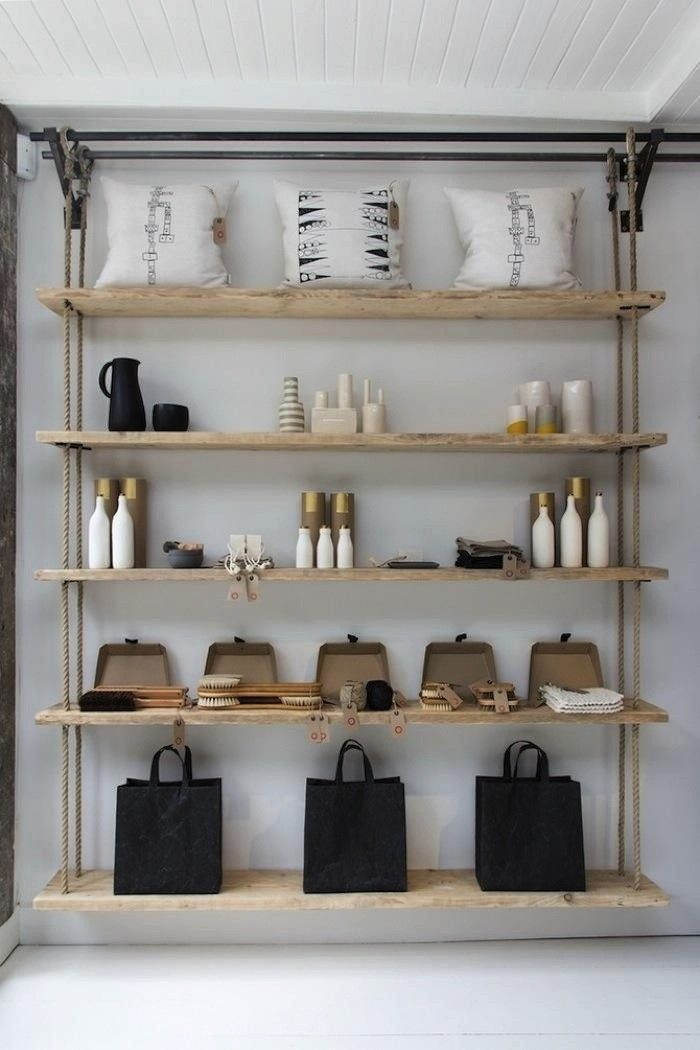 Rope Shelving from the Folklore Shop in London, from Remodelista.com.  Good idea! Can be hung from hooks or brackets with pipes, etc.