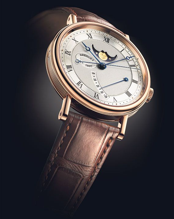 Still in the Classique collection, Breguet is presenting another new model, the Classique 7787 Moon Phases watch. This timepiece is distinctive in that it can be worn equally well by men or women, since it comes in two sizes (39mm and 36mm in diameter). It is proposed in two versions, each of which has a dial that is hand-engraved on a rose engine, one in white gold, the other in 18-carat red gold. Two of the 18-carat red-gold models will also be available with a grand feu enamelled dial…