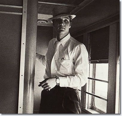 Elvis on Train to, Memphis, Tennessee : July 3, 1956; amusing other passengers by pretending to be The Colonel.