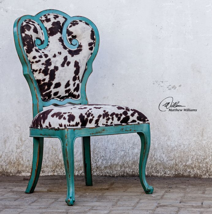 "Aqua blue finish on solid, plantation grown mango wood with cushioned seat in plush, dark chocolate and milky white velvet. Seat height is 19""."