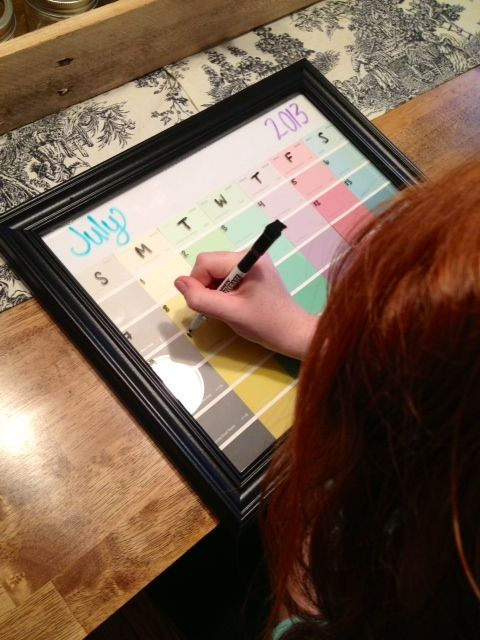 DIY picture frame/paint swatch calendar.  Could be made into a chore calendar or a homeschool keep on task chart