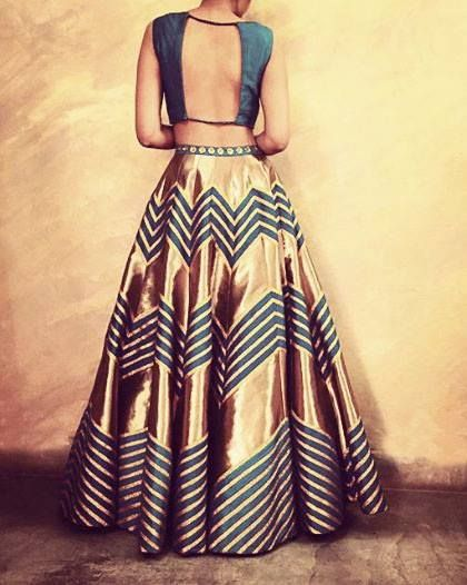 We're in love with the colours and design on this stunner of a lehenga. <3 Gold and teal, with a teal open back blouse. By Priyal Prakash