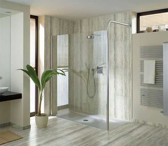 Roman showers never fail to make any bathroom look stylish and spacious! #designinspiration #lookofmarble #colortile