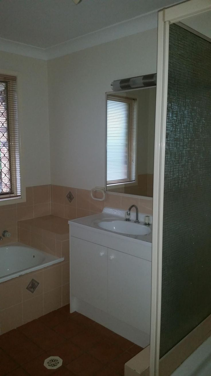Vanity and shower - pre-renovation.