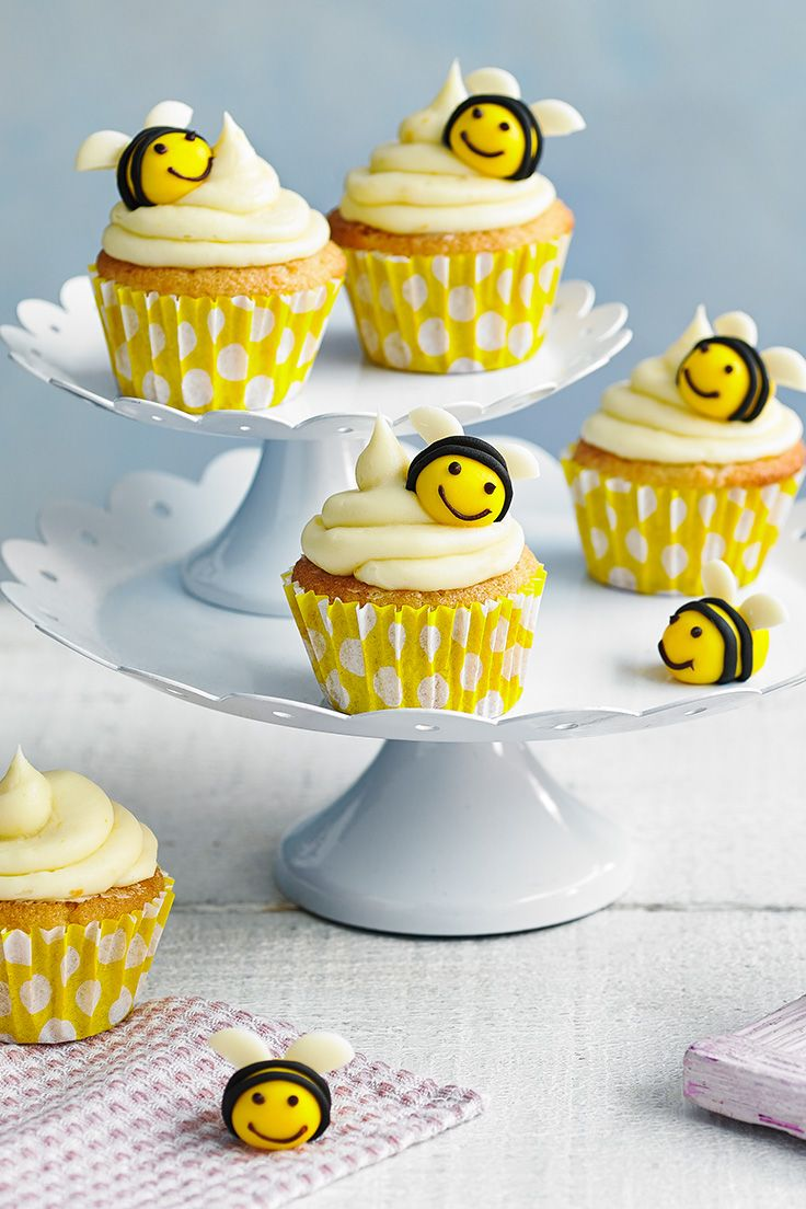 Kids will love preparing these cute bee cupcakes. Studded with white chocolate chips and given a fresh lift with orange zest, these are perfect for an Easter celebration. | Tesco