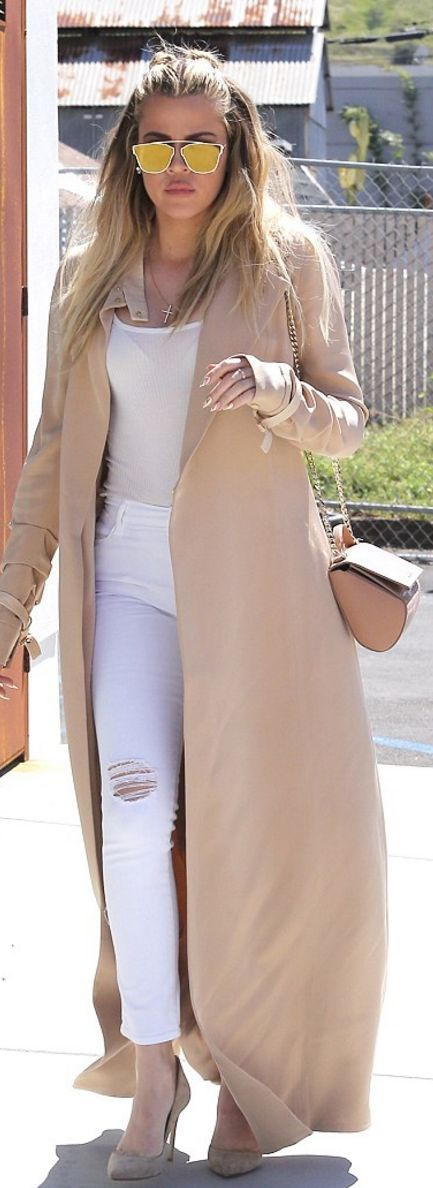 Khloe Kardashian: Ring – Cartier  Purse – Givenchy  Sunglasses – Dior  Jeans – Frame  Shoes – Gianvito Rossi