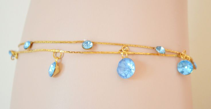 http://www.miss-sexy.it/compra/cavigliera-donna-estiva-oro-con-ciondoli-a-sfere-con-cristalli-azzurre-2526233