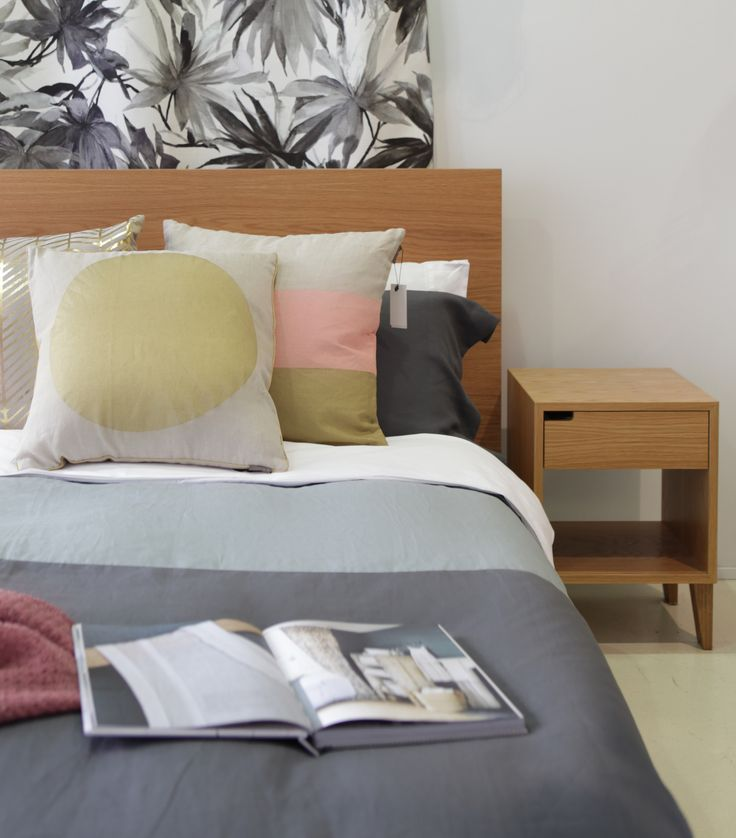 NZ made bed & bedside table with Thread Design duvet and Aura home cushions.