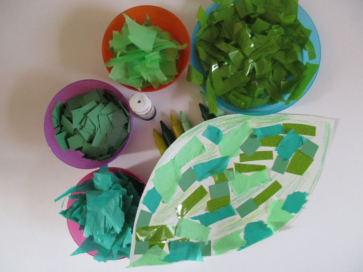 This is a very easy palm leaf craft. The basic shape is cut from construction paper (5 at a time). Then there are two shades of tissue paper, squares of green construction paper and some shiny cell…