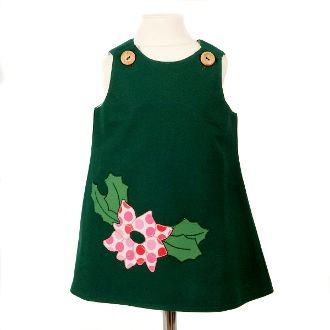 A-line dress made with a lovely brushed cotton fabric, with a flower motif hand embroidered on the front.