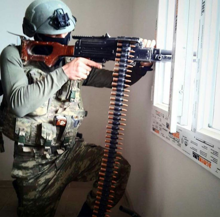 Turkish Gendarmarie SOF member using his PKM machine gun during urban operations against PKK.