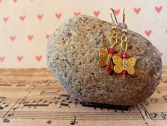 Check out this item in my Etsy shop https://www.etsy.com/au/listing/526400630/butterfly-earrings-red-and-gold