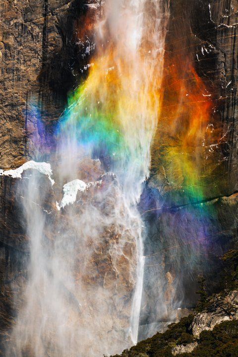 The photographer captured this image as lightning was striking directly through the prism of a rainbow. Beautiful! Yosemite Rainbow Lightning