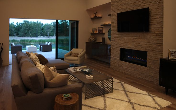 Renovare Model Home. Relax in front of the fire in the main living space of our Mountain Modern styled Model Home in Eagle, Idaho exclusive Renovare Community.