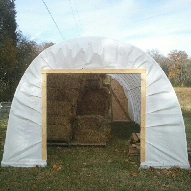 The $500 Hoop House for Hay Storage — LITTLE SEED FARM Interesting way to sandwich the plastic between boards to secure around the doorway.