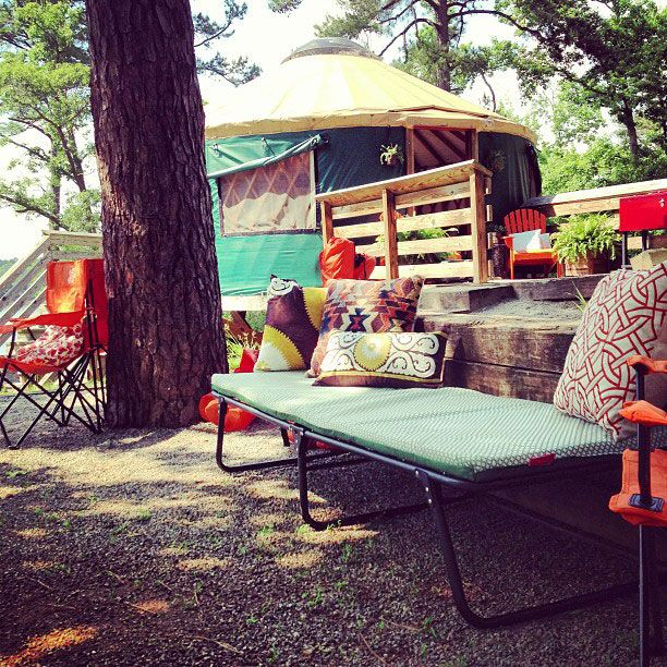 Pair a camp cot with outdoor pillows to create a daybed at your campsite