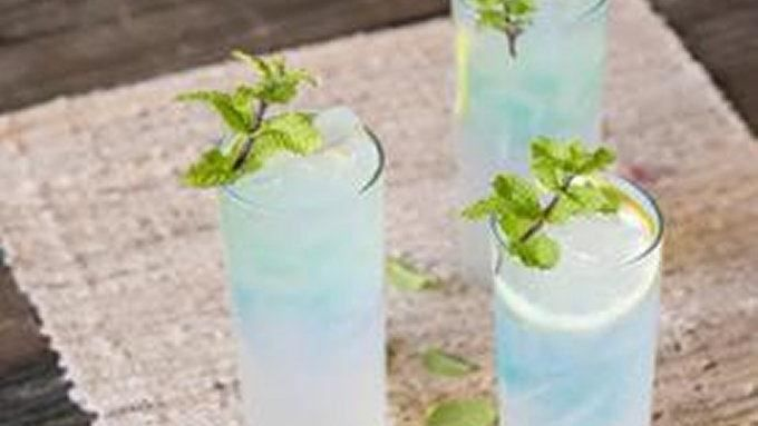 Give your lemonade a shot of blue raspberry vodka for a pretty and good tasting summer cocktail.