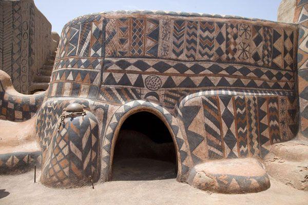 Picture of Tiébélé painted houses (Burkina Faso): Low door of a house for an elder in Tiébélé