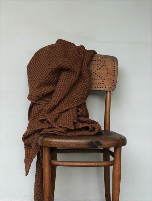 Brown blanket / shawl | Wooden chair