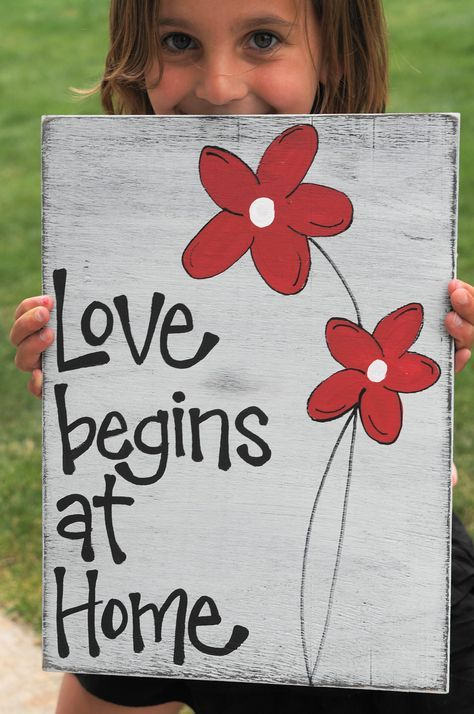 Love Begins at Home wood sign on reclaimed wood
